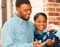 a couple getting the keys to their new home.